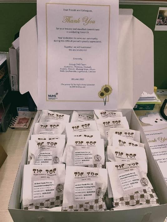 Tip Top curry puffs hand delivered to frontliners at various NUHS facilities.