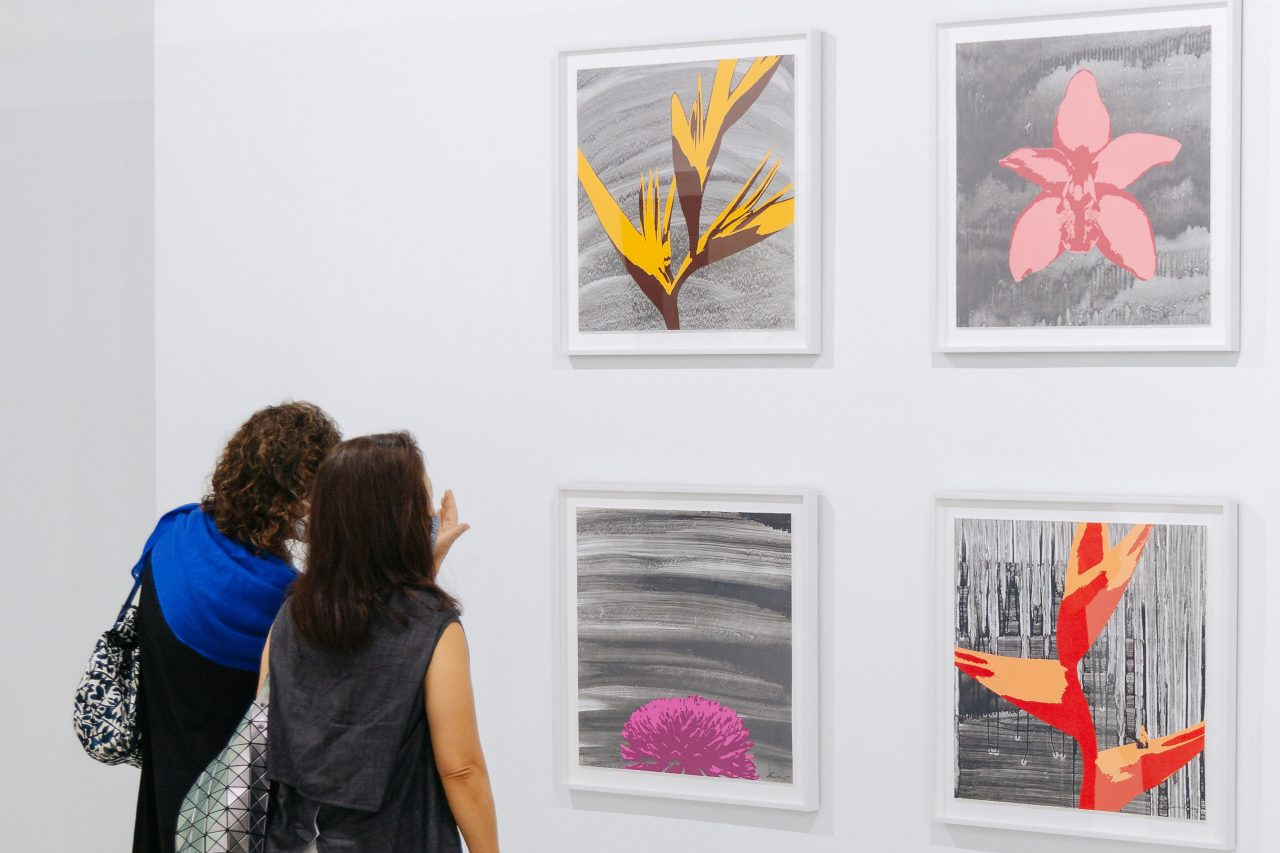 "From upper left, clockwise: Russel Wong, ""Heliconia"", ""Cymbidium Orchid"", ""Heliconia Wagneriana"", ""Chrysanthemum"", 2020. Photolithography on paper, edition of 12, 60 x 60 cm, presented by STPI – Creative Workshop & Gallery. Photo by Toni Cuhadi, courtesy of S.E.A. Focus, Singapore"